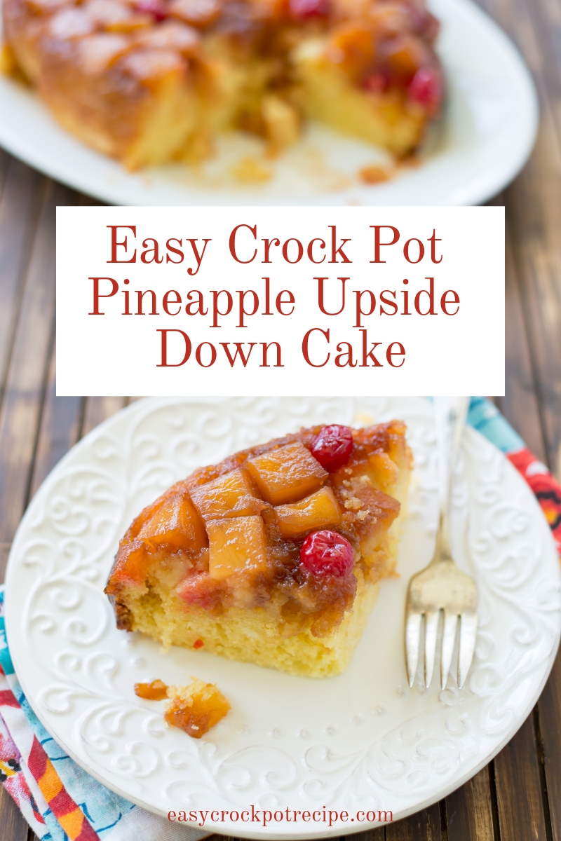 A slice of easy Crock Pot Pineapple Upside Down Cake on a white plate with the entire Pineapple Upside Down Cake in the background.